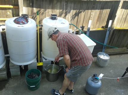 Joe at the rain barrels - boiling RCJAE,LLC (c)2012.jpg